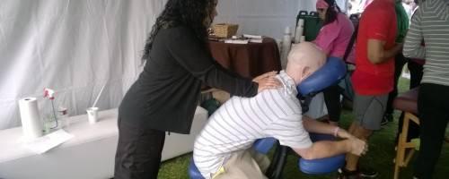 Megan giving massage to cancer Survivor